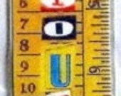 Bookmark.  Laminated.  Feed your mind.  Ruler with alphabetical letters.
