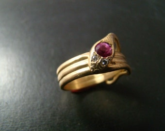 Beautiful 14k gold snake ring with genuine pink sapphire and diamonds