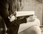 Black and white photography, sepia, girl reading, street photography, book,