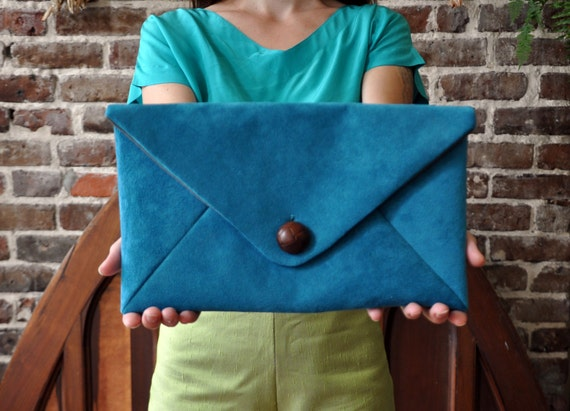 Bold turquoise suede envelope clutch with leather button