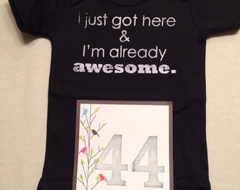 DISCOUNTED -- Nearly Perfect -- #44b, see photos -- I just got here & I'm already awesome.  -- black snapsuit, size 0-3 months
