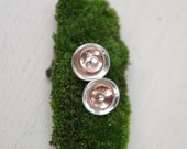 1 pair of Multi Metal sterling silver and copper domed post earrings.