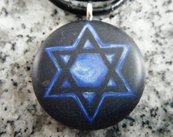 Star of David hand carved on a polymer clay midnight blue color background. Pendant comes with a FREE necklace