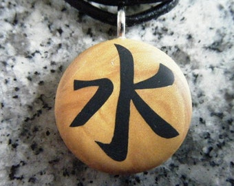 ETERNITY Japanese kanji symbol hand carved on a polymer clay gold pearl color background. Pendant comes with a FREE necklace