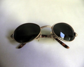 vintage 1980's Sunglasses, eyewear, dark green lens