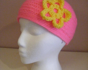 pink beanie with yellow flower