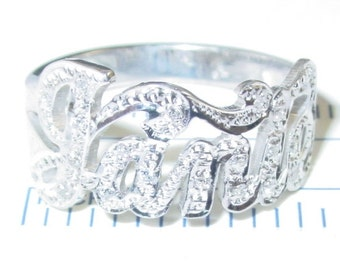 name ring .with 20cz . sterling  silver ,all solid sterling silver .heavy gauge  . any name any size.nr3
