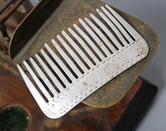 Antique aluminum comb