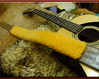 SHEEPSKIN PAD for your Guitar Strap. We will glue a sheepskin pad to your strap or ship it to you so you may attach it yourself.