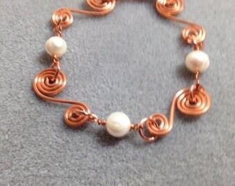 Hand formed,hammered copper & fresh water pearl bracelet