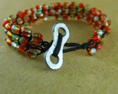 Sparkly Delight: Red and orange beaded bracelet with chain plate clasp