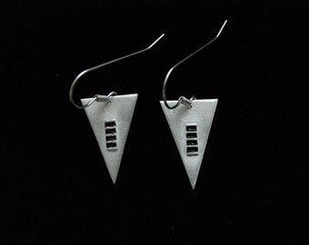 Art deco style triangle, silver dangle earrings with a grid design highlighted with black faux enameling