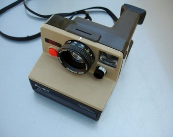 Very Cool Polaroid The Button Instant Camera - We have a Polaroid for you