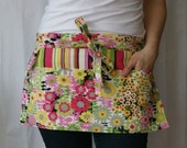 Half Apron with pockets and loop in pink green yellow black and off-white floral and stripes