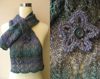 Hand knitted self patterning lacy scarf with pocket. Adult women or teenage girl.