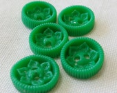 "5 Sm. vintage plastic open work emerald green buttons, 0.5"" ins. Ripple side, central floral well with 2 hole sew through. HM14.6-14.28."