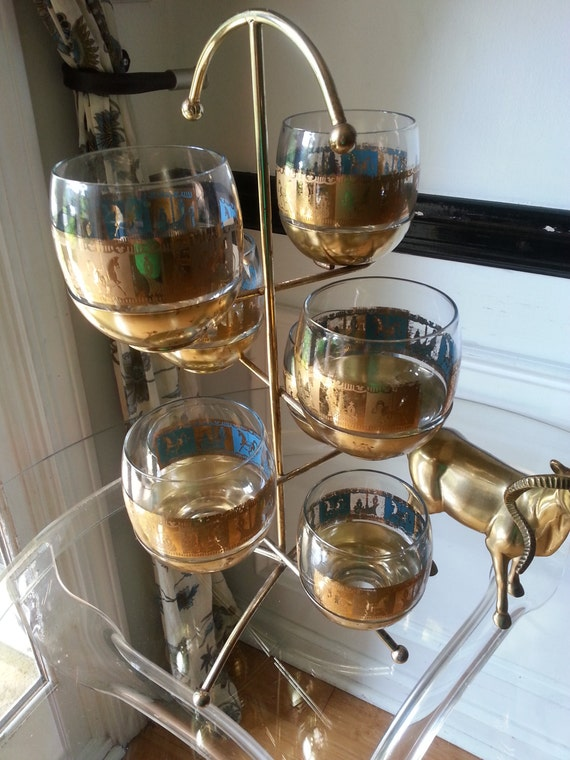 Gold and Blue. Tumblers. Roly Poly. Mid Century Gold Glasses on Tree. Mid Century Gold Glass Holder. Glass Tree. Eames Era