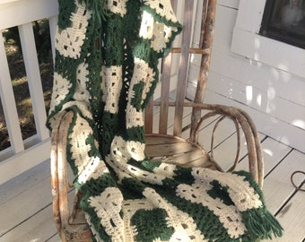 Green and white crocheted afghan