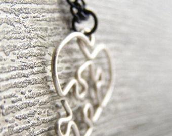 Glow In The Dark Puzzle Piece Heart Pendant