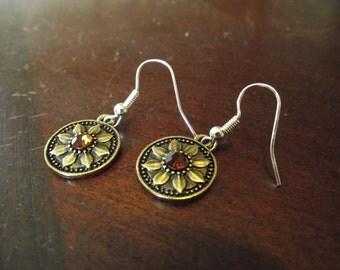 Hook earrings with circle flower pendants