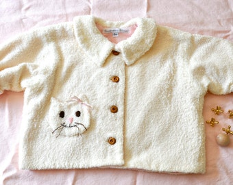 Infant medium weight terry cloth, flannel lined jacket with embroidered cat pocket