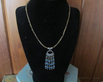 Necklace with gold and blue glass beads