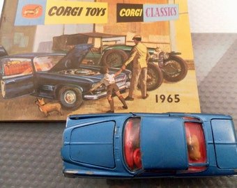 Vintage 1964 Corgi Toys Chrysler Ghia Diecast Car.  Lgt Blue, Red Interior, Jewel Lights & Passenger Dog. Shaped Wheels 1/36 Scale No. 241