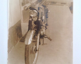Vintage/Antique photo of an old vintage motorcycle