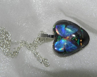 Iridescent small Blue heart shaped butterfly resin pendant with faux dichroic glass background