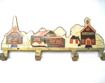 Vintage key rack hook brass church school village enameled cottage decor