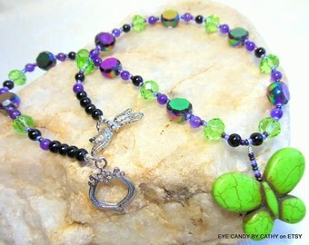Dramatic green butterfly necklace