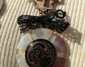 Assemblage Necklace, antique glass button,  jewelry bits, MOP and Lace