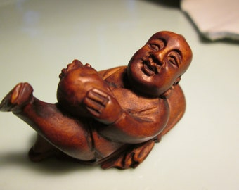 totem netsuke hand carved PEACH PULLER heavy detailed carving cherry stain on birch wood 2 inches very collectible