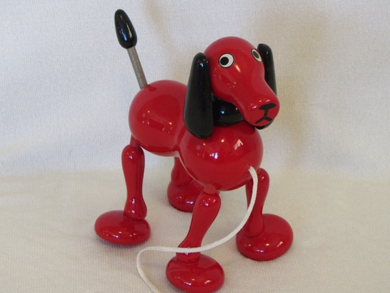 Vintage kouvalias red dog wood pull toy