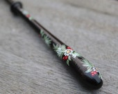Painted Bayeux Lace Bobbin - a spiral of Fir branches, berries and white flowers on Ebony