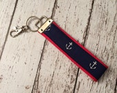 Anchor print key fob wristlet on red cotton webbing with swivel lobster clasp