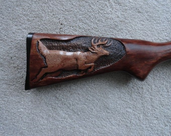 Carved gun stock with running deer