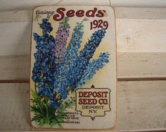old delphinium flowers ,advertising image, catalogue of seeds-label applied to natural wooden tag/dresser/door hanger