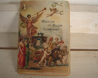 Vintage cherubs & angels, sewing machines advertising label on wood, Victorian trading cards image