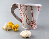 Orange and white abstract hand built mug