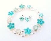 Turquoise green bracelet, ceramic flowers, aqua, celadon