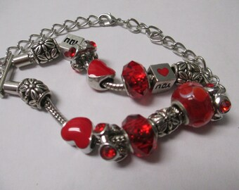 Jewelry Red European style silver toned beaded bracelet with silver toned beads and glass beads