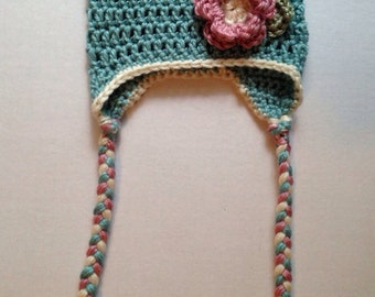 Handmade crochet baby hat with. Ear flaps flower hat