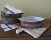 Pyrex Woodland housewarming set hostess bowls brown floral kitchen towel pot holder