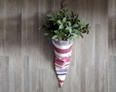 Fabric kitchen storage cone and home decoration in pink to violet stripes