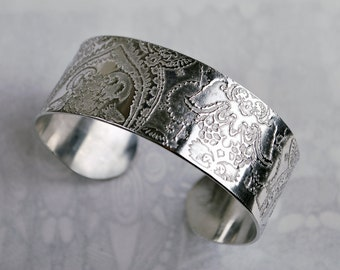 Indian floral design embossed cuff silver aluminium