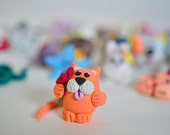 Miniature Orange Cat holding a flower Polymer Clay