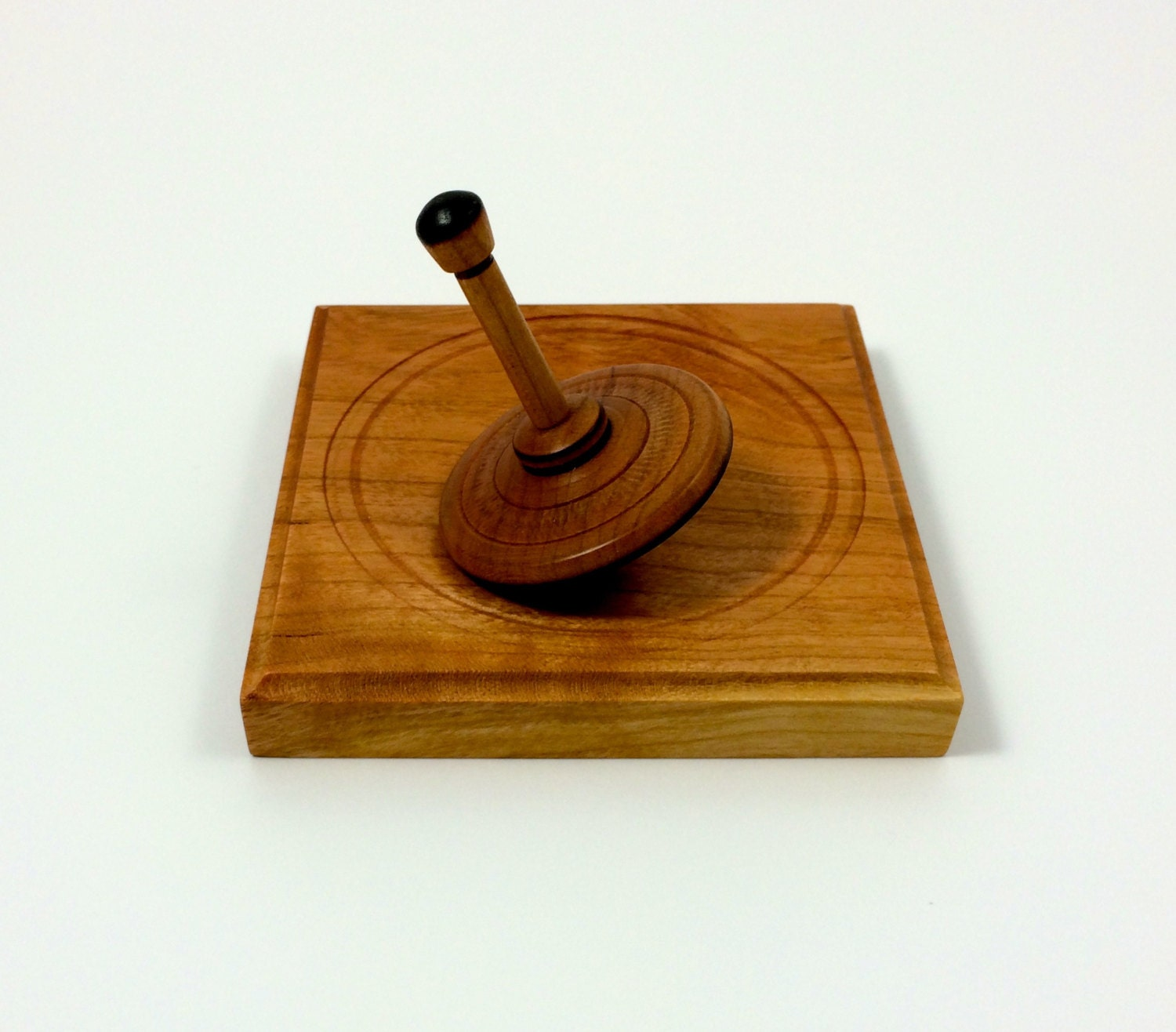 Cherry Wood Spinning Top with Cherry Display Base Natural Wood