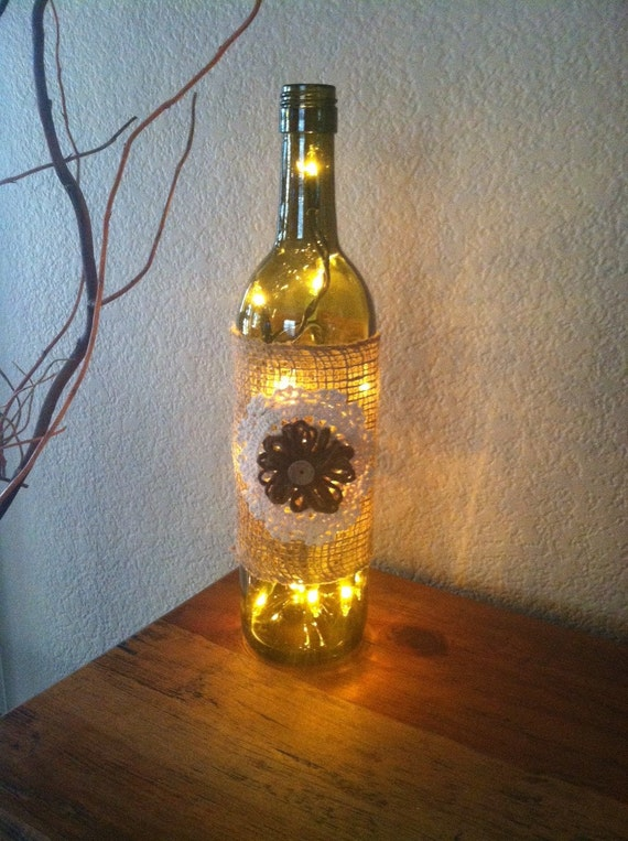 Wine bottle light burlap and flower burlap flower home for Wine bottles decorated with flowers
