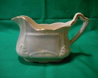 One (1), 6 oz Creamer, from Arthur Wood, in a Pearl Lusterware Finish, with Gold Trim.